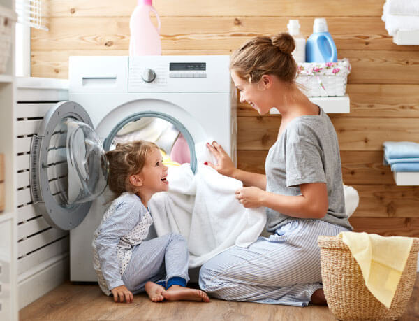 Family in Laundry Room